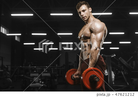 Handsome strong athletic men pumping up muscles workout barbell 47621212