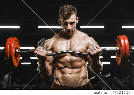 Handsome strong athletic men pumping up muscles workout barbell 47621216