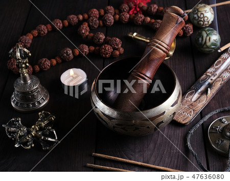 copper singing bowl and a wooden stick  47636080