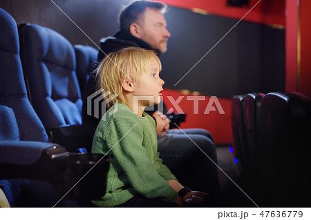 Boy with his father watching cartoon movie 47636779