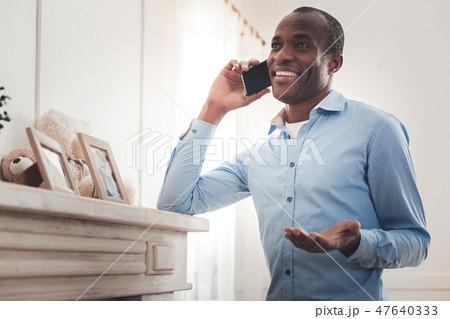 Joyful afro American man talking to his friend 47640333
