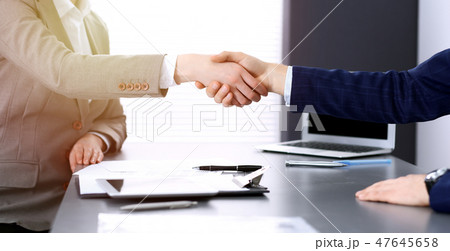 Business people shaking hands, finishing up a meeting. Papers signing, agreement and lawyer 47645658