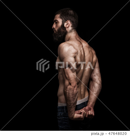 strong athletic beardy mans back isolated 47648020