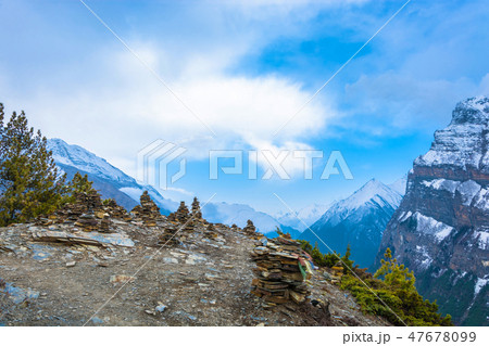 Many small stone stupas on top of the mountain. 47678099