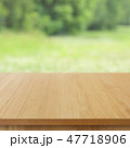 wooden table top on green bokeh background 47718906