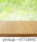 wooden table top on green bokeh background 47718942