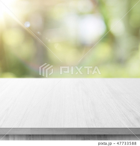 Wooden table with green bokeh background 47733588