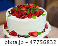 a wedding cake with cream and strawberries 47756832
