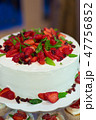 a wedding cake with cream and strawberries 47756852