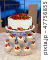 a wedding cake with cream and strawberries 47756855
