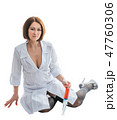 Sexually doctor woman on isolated white background. Caucasian woman medic with big syringe with a 47760306