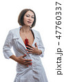 Sexually doctor woman on isolated white background. Caucasian woman medic with big syringe with a 47760337