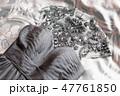 Grey evening dress with many rhinestones on top.  47761850