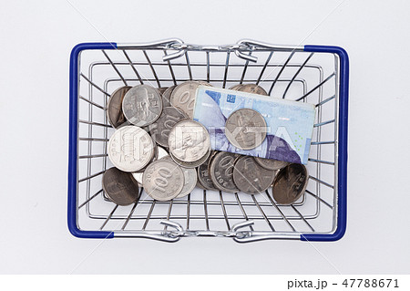 Shopping basket with coins and korean won bills  47788671