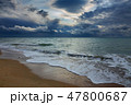 stormy sky over sea and sandy beach 47800687
