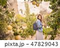 Young Mixed Race Girl Posing at Camera at Yellow Quinces Tree Plantation Garden. Turkey. 47829043