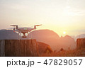 Quadcopter Drone Ready to Take Off. Modern Flying Gadget Waiting Command Against Beautifull Golden 47829057