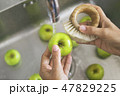 Young Vegan Girl Washing Green Apples with Bamboo Brush. Hand Holding Fresh Fruits Under Running 47829225