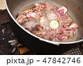 Lamb pieces with whole onion stew 47842746
