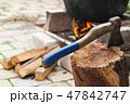 Ax stuck in a log near cauldron 47842747
