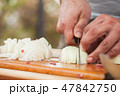 White onion slicing. Cook hands with knife 47842750