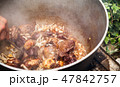 Mixing boiled lamb and vegetables 47842757
