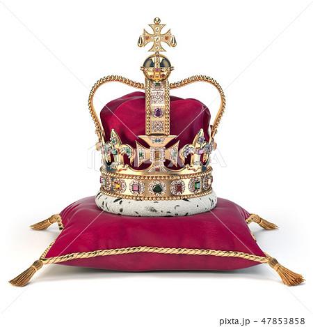 Golden crown on red velvet pillow for coronation 47853858