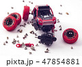 Disassembled car and scattered parts. Broken toy 47854881