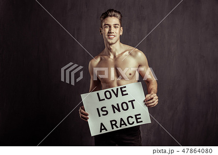 Joyful handsome young man being against racism 47864080