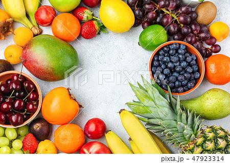 Rainbow fruits background 47923314