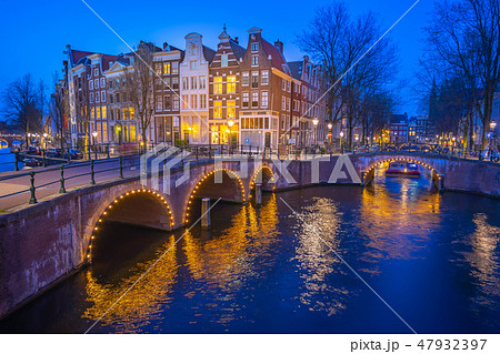 Canals of Amsterdam with dutch buildings at night 47932397