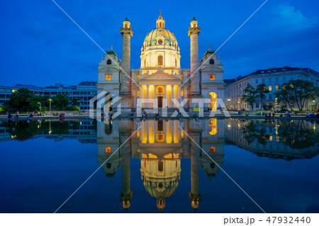 Karlskirche church at night in Vienna, Austria 47932440