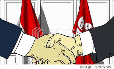 Businessmen or politicians shake hands against flags of Indonesia and Hong Kong. Official meeting or 47975789