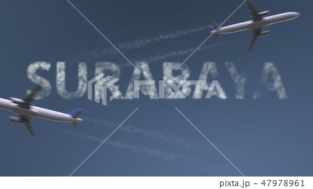 Flying airplanes trails and Surabaya caption. Traveling to Indonesia conceptual 3D rendering 47978961