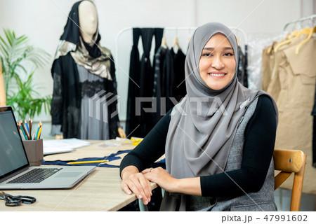 Asian Muslim woman designer in her tailor shop 47991602