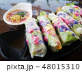 Fresh spring rolls with colorful flowers inside  48015310