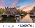 Amsterdam Netherlands, canal sunset city skyline 48069701