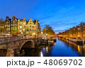 Amsterdam Netherlands, canal sunset city skyline 48069702
