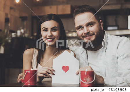 Young romantic woman holding envelope with heart 48103993