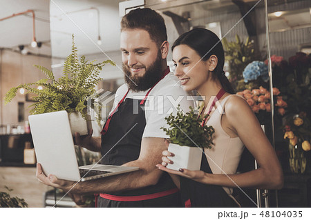 Portrait of smiling florists man and woman 48104035