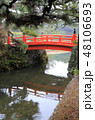 冬の栗林公園、南庭北湖の梅林橋(赤橋) 48106693