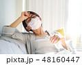 女性 マスク 頭痛の写真 48160447