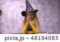 Stargazer girl rubs hands. Close up front view little witch viciously rubs her hands 48194083