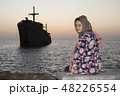 sitting woman with greek ship wreckage in kish 48226554