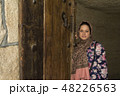 Portrait of a young muslim woman behind wooden 48226563
