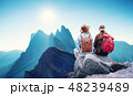 Travelers couple look at the mountains landscape. 48239489