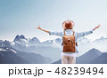 Traveler at the mountains landscape.  48239494