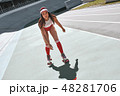 Only forward. Beautiful woman is rollerblading at the skatepark, looking focused 48281706