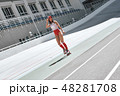 Why walk when you can skate. Beautiful woman is rollerblading at the skatepark, smiling and looking 48281708
