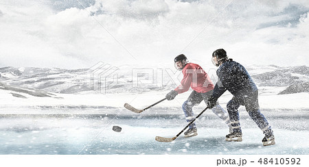 Playing hockey game 48410592